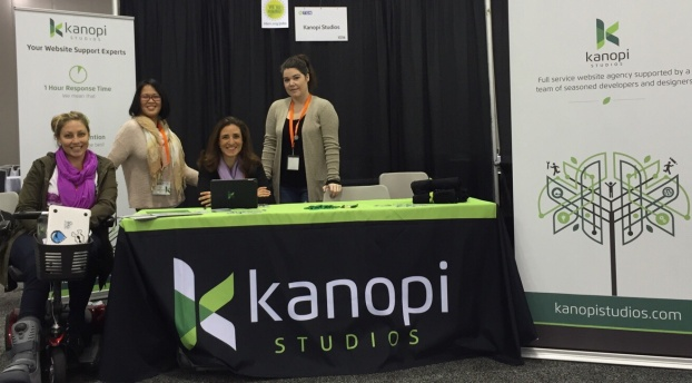 Four Kanopians at the Kanopi booth at NTC 2016 in San Jose.
