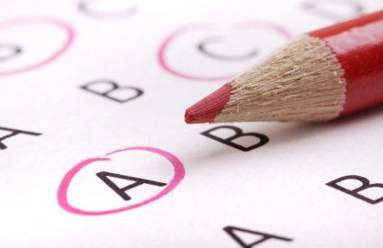 A pencil, circling quiz answers.
