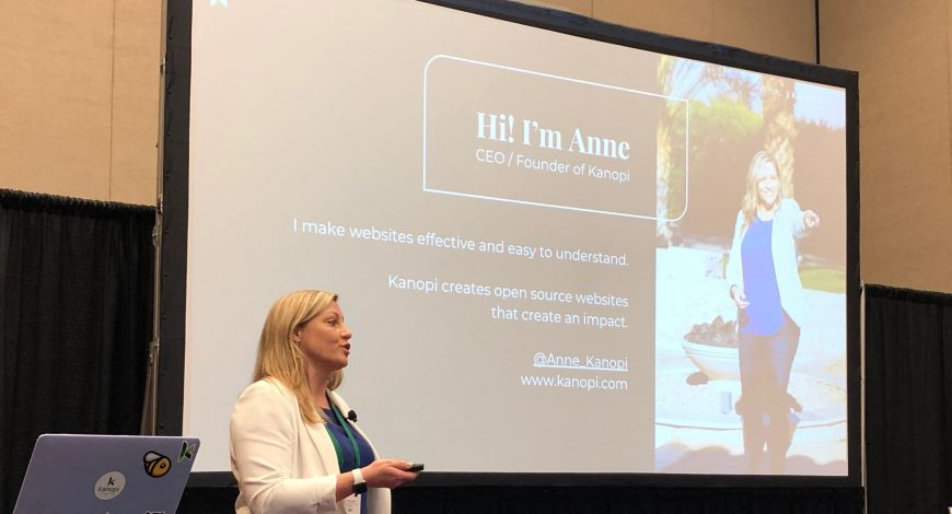 Anne speaking with a presentation