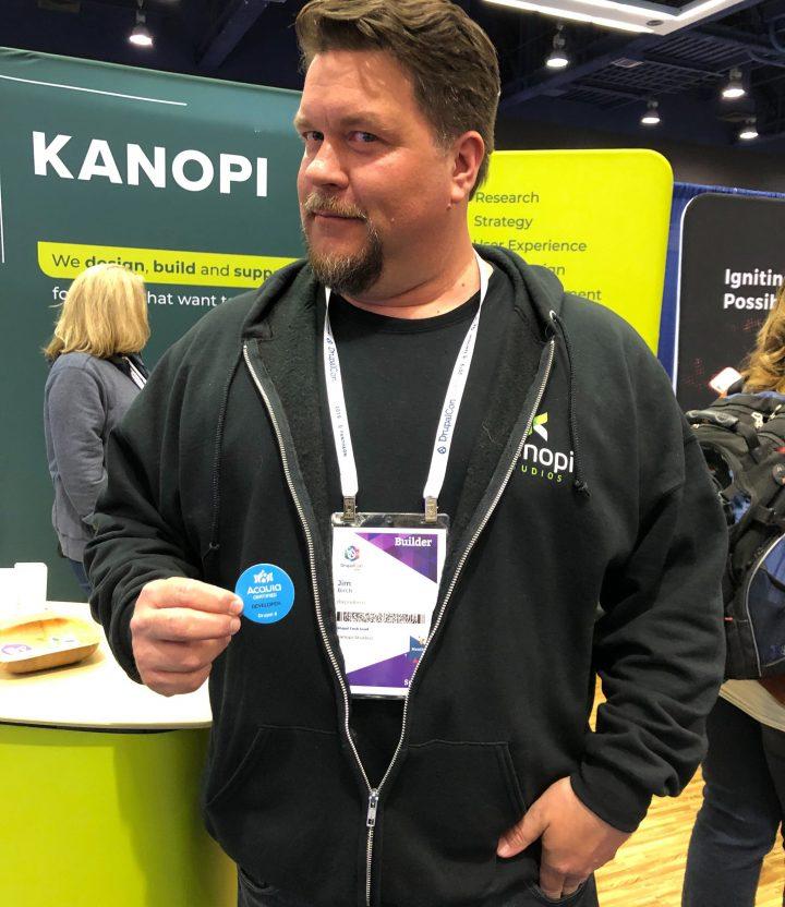 Drupal developer Jim Birch with his Acquia certification badge at DrupalCon