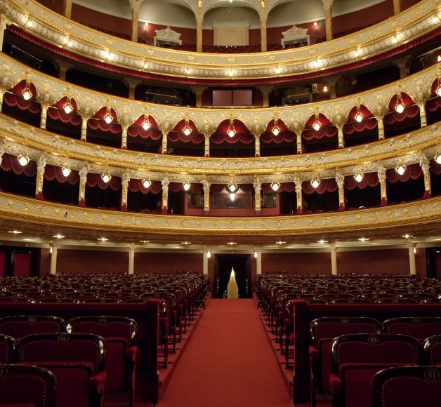 An interior of an auditorium and theatre.