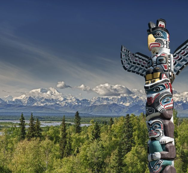 A totem wood pole in mountain background, Vancouver area