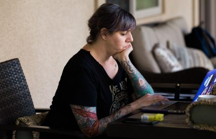 Erin writing on a computer creating accessible content