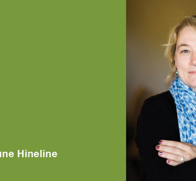 Image of AmyJune Hineline for her Accessible Media webinar. She has a blue scarf and her arms are folded.