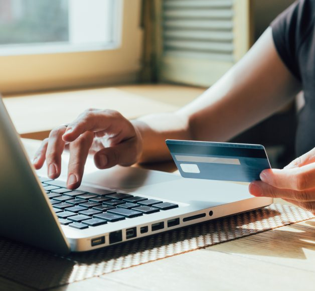 woman shopping with a credit card on a laptop